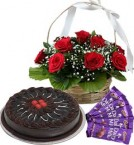 send Half Kg Chocolate Cake Red Roses Basket n Chocolate  delivery