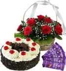 send Half Kg Black Forest Cake Red Roses Basket n Chocolate  delivery