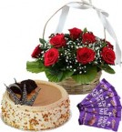 send Half Kg Butterscotch Cake Red Roses Basket n Chocolate delivery