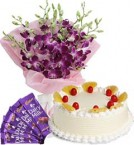 send Pineapple Cake Half Kg Orchids Bouquet n Chocolate delivery