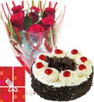 send  Eggless Black Forest Cake Half Kg with Red Roses bunch Combo  delivery