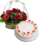 send Eggless Pineapple Cake Half Kg N Red Roses Basket delivery