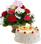 send Pineapple Cake Half Kg n Carnations Basket delivery