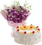send Eggless Pineapple Cake Half Kg N Orchids Bouquet delivery
