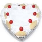send 1Kg Eggless Heart Shape Pineapple Cake delivery