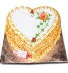 send Half Kg Heart Shape butterskotch Cake delivery