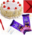 send half kg White Forest cake 2pcs chocolate n card delivery