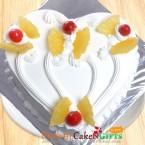 send Half Kg pineapple cake heart shape delivery