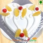 send Half Kg Eggless Pineapple Cake Heart Shape delivery