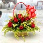 send Lovely Designer Red Roses in a Flower Basket delivery