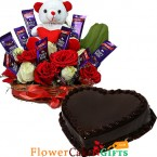 send half kg eggless chocolate cake heart shape n roses flower n teddy chocolate arrangement delivery