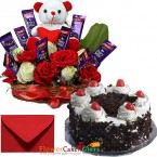 send 1kg eggless black forest cake n special roses teddy chocolate arrangement  delivery