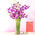 send 12 purple orchid in a vase delivery