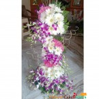 send majestic purple orchid gerberas  tall arrangement delivery