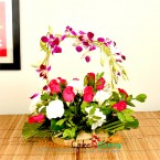 send 8 pink roses 8 white carnations 2 purple orchids in a basket delivery