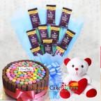 send half kg kitkat gems cake n teddy chocolate bouquet delivery