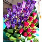 send 10 red roses with 20 dairy milk bouquet delivery