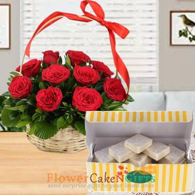 15 red roses basket and half kg kaju barfi sweets