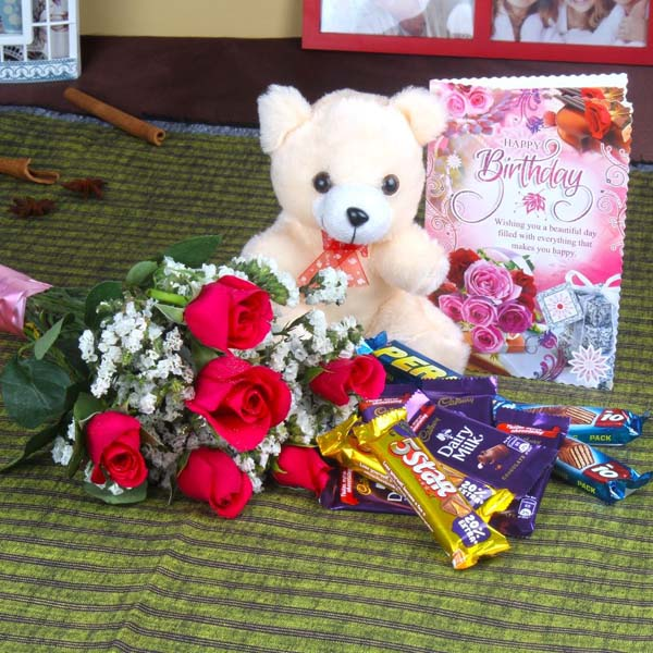 roses with chocolates and teddy bear only for you