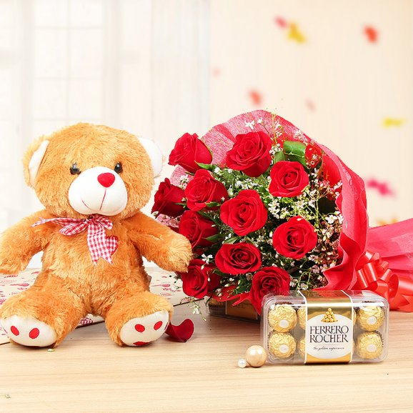 12 red roses bouquet 1 brown teddy 12 inch box of 16 ferrero rocher chocolates